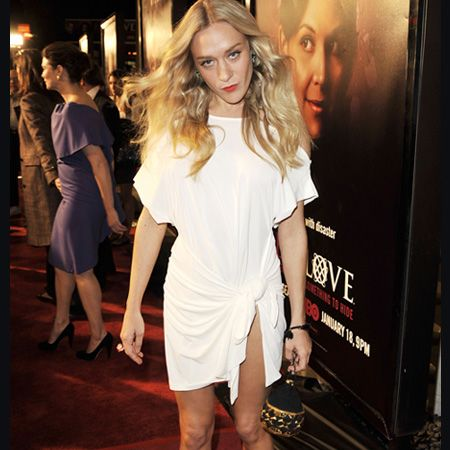 Fashionista Chloe flashes some toned thigh in this ruched white dress. Do you think her look is a trend-setter or trashy?<br />