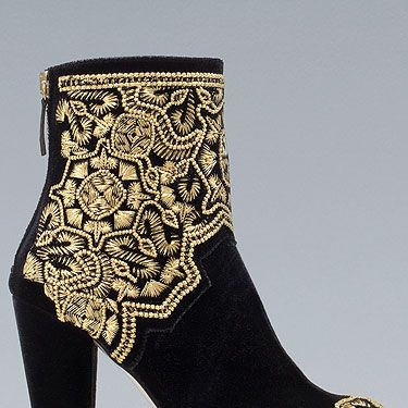 """<p>These Balmain-inspired brocade boots are so hip it practically hurts! We spotted lots of fashion editors rocking embroidered black and gold combos at Somerset House this season.</p><p>Embroidered boots, £99.99, <a title=""""http://www.zara.com/webapp/wcs/stores/servlet/product/uk/en/zara-W2012/287002/958505/GOLD%20EMBROIDERED%20HIGH-HEEL%20ANKLE%20BOOT """" href=""""http://www.zara.com/webapp/wcs/stores/servlet/product/uk/en/zara-W2012/287002/958505/GOLD%20EMBROIDERED%20HIGH-HEEL%20ANKLE%20BOOT%20"""" target=""""_blank"""">Zara</a></p><p><a title=""""http://cosmopolitan.co.uk/fashion/celebrities-at-london-fashion-week-ss13?click=main_sr"""" href=""""http://cosmopolitan.co.uk/fashion/celebrities-at-london-fashion-week-ss13?click=main_sr"""" target=""""_blank"""">SEE THE CELEBS ON THE FRON ROW OF LFW</a></p>"""