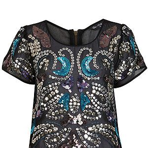 <p>Ooh, this sheer shirt is a beaut. Perfect for party season, but we want to dress it down with ripped jeans and heels, cos we're oh-so nonchalant like that...</p>