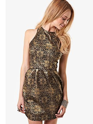 """<p>Brocade is, like, EVERYWHERE this season, and you've got to be in it to win it. So why not slip into this cheap-as-chips structured style from Fashion Union? For just £22, you'd be cray cray not to!</p> <p>Brocade print dress, £22, <a href=""""http://www.fashionunion.com/mini-dresses/black-gold-brocade-print-dress/invt/wdrm0091blk/%20"""" target=""""_blank"""">Fashion Union </a></p>"""