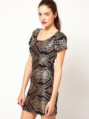 """<p>This Vero Moda baroque style frock is super ornate and the perfect LBD update. Wear with black heels and a swipe of red lippy and let your dress do the talking.</p> <p>Vero Moda Baroque Dress, £50, <a href=""""http://www.asos.com/pgeproduct.aspx?iid=2444309&SearchQuery=mini%20dress&sh=0&pge=0&pgesize=20&sort=-1&clr=Black&xr=1&mk=na&r=3&r=2"""" target=""""_blank"""">Asos.com </a></p>"""