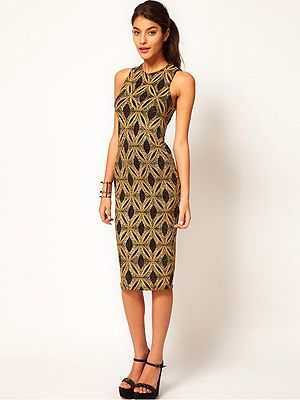 """<p>Sound the style steal klaxon! We love this ritzy-glitzy dress from Asos. The demure knee length combined with sexy cut away back make it super versatile for day or night - ideal for party season!</p> <p>Bodycon Dress in Baroque Glitter Print, £32 (from £40), <a href=""""http://www.asos.com/ASOS/ASOS-Bodycon-Dress-in-Baroque-Glitter-Print/Prod/pgeproduct.aspx?iid=2333484"""" target=""""_blank"""">Asos.com </a></p>"""