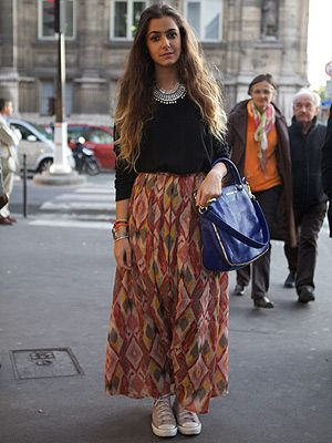 <p><em>Jewellery designer</em></p> <p>We love seeing designers wearing their own work at the shows. Jewellery designer Nisrine Harakat matched her bracelets with a classic Givenchy bag then dressed the outfit down with Converse and tucked an H&M jumper into a skirt she also made herself.</p>