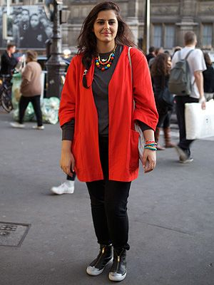 <p><em>Jewellery designer</em></p> <p>We couldn't take our eyes off of Sara Harakat's red vintage coat from Le Marais at Paris Fashion Week. She completed this hip look with trousers from Uniqlo and Marc Jacob shoes and jewellery she made herself. We love this combo!</p>