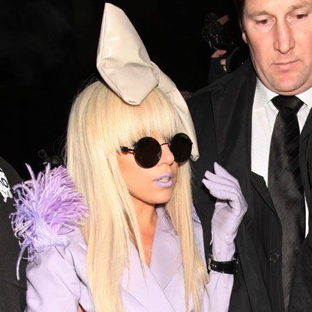 Lady GaGa leaves KOKO in Camden with an oversized bow perched on her head and purple lips that matched her jacket. Either that or she was just feeling the cold in her skimpy outfit...  <br />