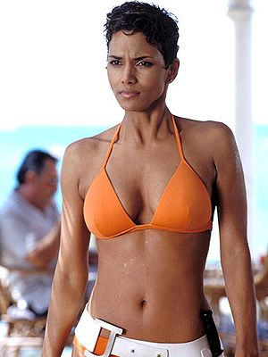"<p>How can we forget Halle Berry emerging out of the water in that fabulous orange bikini as Jinx Johnson in Die Another Day? She heats things up with Pierce Brosnan as another sexed-up Bond girl!</p> <p><strong>Top secret tip</strong>: <a href=""http://www.boots.com/en/Black-and-White-Pluko-Hair-Dressing-Pomade-50ml_873139/?CAWELAID=334511675&cm_mmc=Shopping%20Engines-_-Google%20Base-_---_-div%20classeditContentAreaBlack%20and%20White%20Pluko%20Hair%20Dressing%20Pomade%2050mldiv"" target=""_blank"">Black and White Pluko Hair Dressing Pomade</a> is the perfect weapon for sculpting shorter hair into this spikey style.</p>"