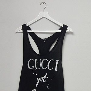 """<p><span lang=""""EN-US"""">We're getting our urban swag on this season! Designed by Simeon Farrar, this tongue-and-cheek monochrome slogan T-shirt is an absolute must-have. </span></p><p>Gucci Got Game Vest, £45, <a href=""""http://www.3939shop.com/products/black-score-gucci-t-shirt"""" target=""""_blank"""">3939 Shop London </a></p>"""