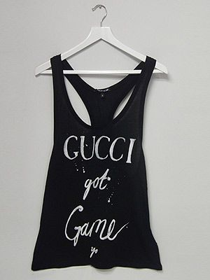 "<p><span lang=""EN-US"">We're getting our urban swag on this season! Designed by Simeon Farrar, this tongue-and-cheek monochrome slogan T-shirt is an absolute must-have. </span></p> <p>Gucci Got Game Vest, £45, <a href=""http://www.3939shop.com/products/black-score-gucci-t-shirt"" target=""_blank"">3939 Shop London </a></p>"