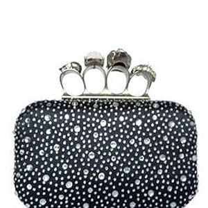 """<p>Get the McQueen look for less with this skull and diamante four-ring clutch bag! It's super stylish for a swanky night out, but punky enough to use as a acsual everyday bag. And the studs are a deal breaker!</p><p>LYDC Black Diamanté encrusted evening bag, £30, <a href=""""http://www.brandvillage.co.uk/products/Black-Diamant%C3%A9-encrusted-evening-bag.html"""" target=""""_blank"""">Brand Village </a></p>"""