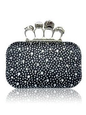 <p>Get the McQueen look for less with this skull and diamante four-ring clutch bag! It's super stylish for a swanky night out, but punky enough to use as a acsual everyday bag. And the studs are a deal breaker!</p>