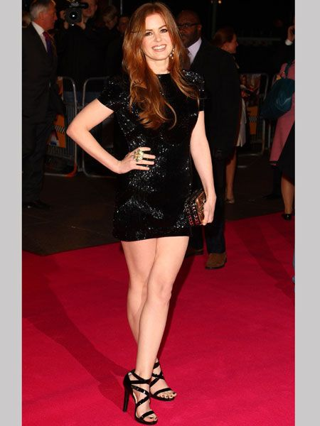 At the London premiere of <em>Confessions Of A Shopaholic</em>, the star sparkled on the red carpet in a sequined Jasmine di Milo mini dress paired with patent Jimmy Choo sandals that showed-off her perfect pins.  <br />