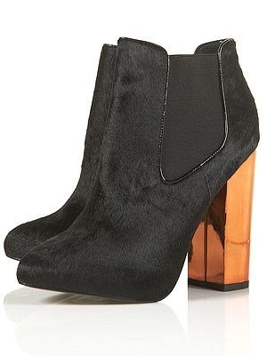 """<p>It's officially winter, and you know what that means. Kicking back and relaxing with a hot cuppa. There's no better way to accessorise this season than with a pair of black pony-inspired heels to remind you of the countryside up north.</p> <p>Alcatraz Electric Heel Boots, £78, <a href=""""http://www.topshop.com/webapp/wcs/stores/servlet/ProductDisplay?beginIndex=1&viewAllFlag=&catalogId=33057&storeId=12556&productId=8070144&langId=-1&sort_field=Relevance&categoryId=208544&parent_categoryId=208492&pageSize=200"""" target=""""_blank"""">Topshop</a></p>"""