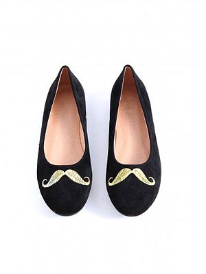 """<p>Although we may all disagree on whether men should sport moustaches (like, ever), we can at least agree that girls look just as great with this Movember stamp. This is definitely our favourite pick.</p> <p>Tierra Moustache Pump, £19.99, <a href=""""http://www.missguided.co.uk/catalog/product/view/id/50265/s/tierra-moustache-pumps/category/641/"""" target=""""_blank"""">Missguided</a></p>"""