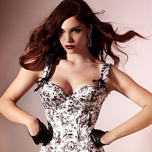 <p>Any gal is guaranteed to feel sexy, confident and sophisticated in this uhh-maze corset from Ann Summers' limited edition Voyeur collection. Made from silky smooth satin with a naughty print, the corset will create a sexy and seductive silhouette. Make a real impact with the matching Voyeur briefs.</p>