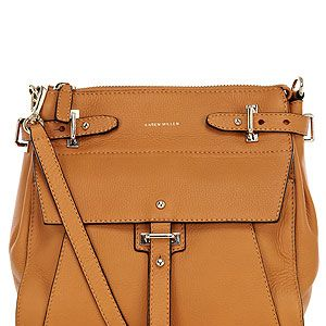 <p>Who doesn't love a satchel bag? Sling it over you for hands-free style. This caramel-coloured squishy number from Karen Millen has chic silver fittings and an adjustable strap. Little bit in love...</p>