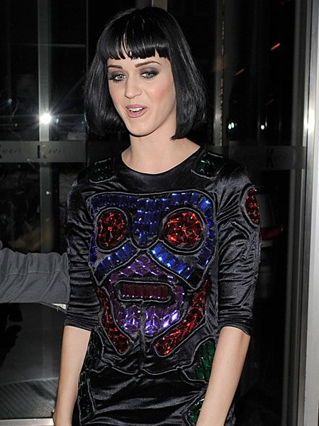 Katy Perry arrived back at her hotel after a show stopping performance at Camden's KOKO in this bizarre jewel-encrusted top and wet look leggings...  <br />