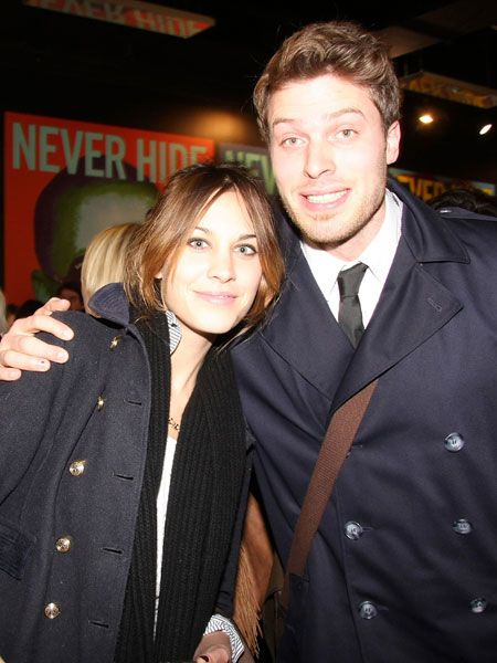 T4 presenters Alexa Chung and the gorgeous Rick Edwards posed happily for photographers at the launch of Ray-Ban Colorize at Selfridges. And who wouldn't, being that effortlessly beautiful...  <br />
