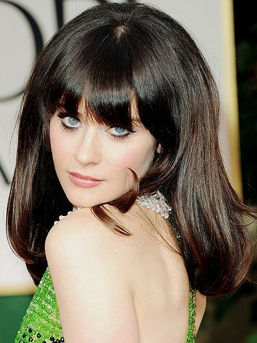 We eagerly awaited Zooey Deschanel Golden Globes look and she didn't disappoint. Zooey went for a 50s vibe with a thick feline flick, big lashes, nude lip and full bodied hair - Bardot chic