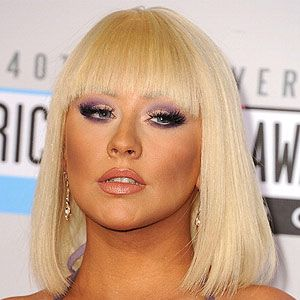 <p>Move over Britney Spears, singer Christina Aguilera just joined the fringe pack! She showed up at the American Music Awards flaunting her platinum blonde hair in a blunt bob hairstyle. She wore her front fringe right below her eyebrows and paired it with a nude lip to really focus this beauty look on her smoky eyes.</p>