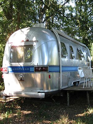 """<p>If you're looking for somewhere to get your creative juices flowing or simply want to escape the crowds, this bohemian nugget in Aquitane countryside near Bordeaux is a must-visit.</p> <p>The silver 1970s Airstream caravan in a sun-drenched field has homespun charm thanks to chic interiors – battered leather chairs, wood floors, cute little curtains – by owners Sara (British) and Stéphane (French). Best of all it comes stocked full of goodies like chorizo, bread, cheeses, Sara's homemade pesto and red wine, so you don't have to worry about shopping for boring things like butter pre-arrival and can get on with more important matters, like sipping a glass of wine on the deck.</p> <p>Aside from the funky Airstream, you also get a natural swimming pool in an adjacent field (complete with mosquito-eating fish, genius) and a writer's hut. This wood cabin has little more than a desk, chair and day bed, yet it's just what you need for some headspace - or snooze space, in my case, on the lounger outside.What? It was 28 degrees! Could it get any better? Yes.</p> <p>There's a hammock slung between some trees, a well-stocked veggie patch you're invited to pick at and use of a 2CV car. Believe me, nothing makes you feel more French than picking up baguettes in the local village then driving back with them sticking out of the open-top roof, dodging hens, cats and dogs as you arrive at the retreat. Living the dream, if only for a couple of days.</p> <p><em>From £107 per night.</em></p> <p><a title=""""http://www.canopyandstars.co.uk/frenchretreat"""" href=""""http://www.canopyandstars.co.uk/frenchretreat"""" target=""""_blank"""">The French Retreat</a></p>"""