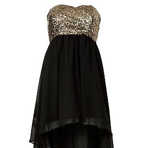 """<p>Sequins automatically get us in the Christmas spirit. This mullet hemline is still a massive trend.<br /> <br /> Gold and black dress, £29.99, <a href=""""http://www.newlook.com/shop/womens/dresses/parisian-gold-sequin-black-dip-hem-dress_272797201%20%20"""" target=""""_blank"""">New Look</a> </p>"""