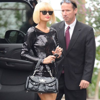 Paris Hilton was clearly channeling the style of Lady GaGa in this short sequined number, closely cropped blonder hair and black shades for a photoshoot in Santa Monica...  <br />
