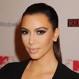 """<p>Kim Kardashian's sexy ponytail is so hot this season, and it's easy to maintain. Spray a soft bristle brush with <a href=""""http://www.boots.com/en/Tresemme-Superior-Hold-Touchable-Feel-hairspray_1106547/"""" target=""""_blank"""">TRESemm<span class=""""st"""">é</span> Superior Hold Hairspray</a>, comb through and tie your hair up tightly with an elastic.</p><p>""""Once hair is tied back with a soft brush or comb repeat brushing hair from the face back to the pony tail to get rid of any looser areas,"""" says Matthew Curtis, TRESemm<span class=""""st"""">é</span> UK lead stylist. """"Take a small section of hair out the ponytail and wrap around the hair band, pinning it in place to give it a finished look and to hide the hair band.""""</p><p>Finish with <a href=""""http://www.boots.com/en/TRESemme-Smooth-glossing-spray-75ml_1222316/"""" target=""""_blank"""">TRESemm<span class=""""st"""">é</span> Smooth Glossing Spray</a> to give is that glamourous, glossy and expensive feel.</p>"""