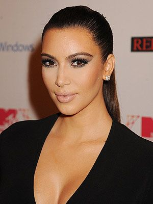 "<p>Kim Kardashian's sexy ponytail is so hot this season, and it's easy to maintain. Spray a soft bristle brush with <a href=""http://www.boots.com/en/Tresemme-Superior-Hold-Touchable-Feel-hairspray_1106547/"" target=""_blank"">TRESemm<span class=""st"">é</span> Superior Hold Hairspray</a>, comb through and tie your hair up tightly with an elastic.</p> <p>""Once hair is tied back with a soft brush or comb repeat brushing hair from the face back to the pony tail to get rid of any looser areas,"" says Matthew Curtis, TRESemm<span class=""st"">é</span> UK lead stylist. ""Take a small section of hair out the ponytail and wrap around the hair band, pinning it in place to give it a finished look and to hide the hair band.""</p> <p>Finish with <a href=""http://www.boots.com/en/TRESemme-Smooth-glossing-spray-75ml_1222316/"" target=""_blank"">TRESemm<span class=""st"">é</span> Smooth Glossing Spray</a> to give is that glamourous, glossy and expensive feel.</p>"