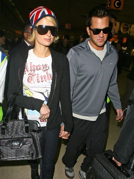 "Paris Hilton was showing her love for the UK with her Union Jack hat as she headed to Heathrow with boyfriend <a target=""_blank"" href=""men/man-watch/gallery"">Doug Reinhardt</a>. The heiress spent her brief break over here parting at almost every single exclusive club in London...  <br />"