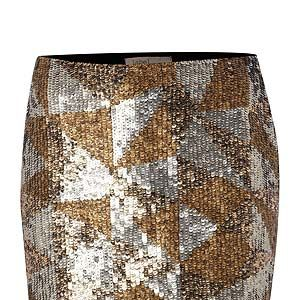 """<p>Shine like a star in this 'mazing metallic mini, available in the House of Fraser sale which starts on Boxing Day. Pair with a marl grey sweater and studded boots for laid back luxe.</p><p>Label Lab metallic mini skirt, £59.40 (was £99), <a href=""""http://www.houseoffraser.co.uk/"""" target=""""_blank"""">House of Fraser </a></p>"""
