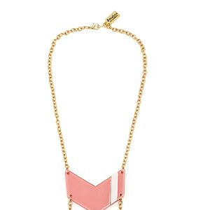 <p>Add a bit of bling to your everyday look with this glam pink insignia necklace, which sort of points to your chest, which is nice. Showcasing the goods, as it were.</p>