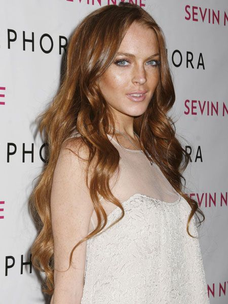 """<a href=""""tags/Lindsay-Lohan/"""">Lindsay Lohan</a> launched her new Sevin Nyne tanning product in California. She seemed to have applied plenty of it to her face but forgot to do the rest of her body - though judging by her pristine white lace dress, she probably didn't want to get any of it on her outfit..."""