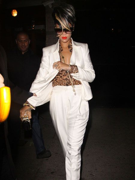 Rihanna has been a busy bee since lying low and taking a well deserved break in her native Barbados. The singer is back on the scene and showcasing new blonde highlights and lots of glamorous outfits. Here she is in a white blazer and leopard-print shirt tucked into white high-waisted trousers as she left posh New York eatery De Silano. And standing under her minder's umbrella-ella-ella...  <br />