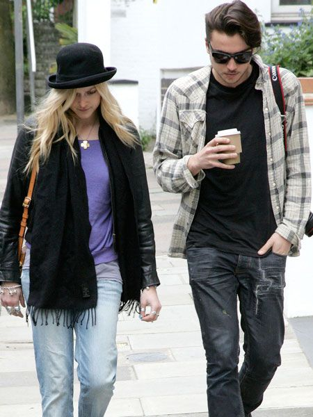 Fearne Cotton has gone all Charlie Chaplin on us in a black bowler hat as she strolled through leafy Hampstead with a mystery male companion...