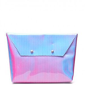<p>Iridescent accessories are where it's at for spring, and Somewhere Nowhere's cleverly crafted clutch coolly uses holographic materials for a truly statement-making effect. Showcase this bold accessory against block colours to let the accessory shine.</p>