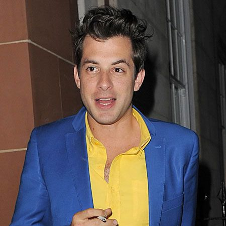 An effortlessly cool Mark Ronson was caught sneaking out for a crafty cigarette during a night of cocktails at London's exclusive Cipriani...  <br />