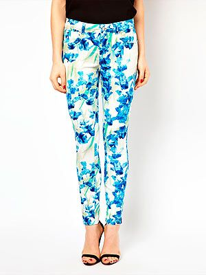 """<p>With this miserable cold weather only one thing will do to cheer us up. These gorgeous bright blue iris print Karen Millen trousers. Best worn with a print blouse and neon heels.</p> <p>Karen Millen jeans, £85, <a href=""""http://www.asos.com/Karen-Millen/Karen-Millen-Skinny-Jeans-in-All-Over-Iris-Print/Prod/pgeproduct.aspx?iid=2829280&cid=2623&sh=0&pge=2&pgesize=20&sort=-1&clr=Blue+multi"""" target=""""_blank"""">Asos</a></p>"""