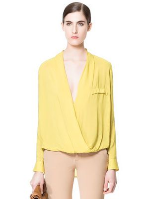 """<p>Yellow was everywhere at London Fashion Week, from Rihanna for River Island to Jonathan Saunders. If you're not up for neon yellow, go for pale with this super-feminine draped blouse from Zara with just the right amount of cleavage.</p> <p>Blouse, £29.99, <a href=""""http://www.zara.com/webapp/wcs/stores/servlet/product/uk/en/zara-neu-S2013/363008/1121143/DRAPED%20BLOUSE"""" target=""""_blank"""">Zara</a></p>"""