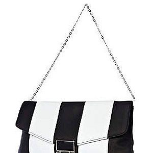 "<p>No need to choose! This arm candy from River Island combines both. We love the futuristic look with the stripes and square lock - the monochrome accessory you need.<br /><br />Mono stripe bag, £18, <a href=""http://www.riverisland.com/women/bags--purses/clutch-bags/Black-and-white-stripe-flip-lock-clutch-bag-632750%20"" target=""_blank"">River Island</a></p>"