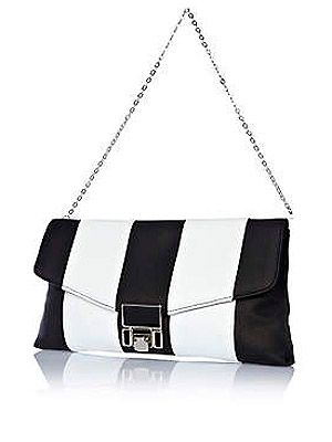 """<p>No need to choose! This arm candy from River Island combines both. We love the futuristic look with the stripes and square lock - the monochrome accessory you need.<br /><br />Mono stripe bag, £18, <a href=""""http://www.riverisland.com/women/bags--purses/clutch-bags/Black-and-white-stripe-flip-lock-clutch-bag-632750%20"""" target=""""_blank"""">River Island</a></p>"""