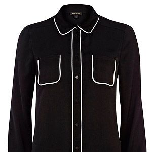 """<p>Ever wished you could go to work in your pyjamas? Well, now you can (sort of). We love the contrast piping detail on this River Island shirt - and reckon it's a s comfy as a pair of PJs, too.</p><p>Black piped shirt, £25, <a href=""""http://www.riverisland.com/women/blouses--shirts/shirts/Black-long-sleeve-piped-shirt-634454%20"""" target=""""_blank"""">River Island</a></p>"""