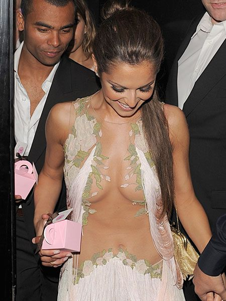 Cheryl Cole was almost in her birthday suit as she celebrated her 26th year with friends and hubby Ashley Cole at Vanilla club in London. The gorgeous singer showed off her skinny frame in a £4,000 Alexander McQueen dress, though there wasn't much in the way of material for all that cash...  <br />