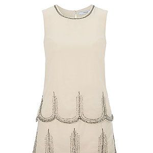 """<p>Channel the prohibition era with this cream Charleston dress with intricate beading and scallop layers – a steal at £25. </p><p>Dress, £25, <a href=""""http://direct.asda.com/george/womens/dresses/charleston-dress/G004201986,default,pd.html"""" target=""""_blank"""">George at Asda</a></p>"""