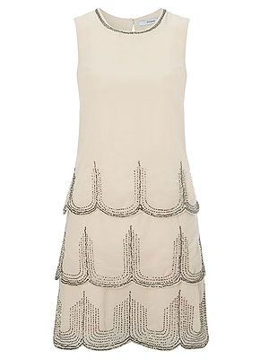 """<p>Channel the prohibition era with this cream Charleston dress with intricate beading and scallop layers – a steal at £25. </p> <p>Dress, £25, <a href=""""http://direct.asda.com/george/womens/dresses/charleston-dress/G004201986,default,pd.html"""" target=""""_blank"""">George at Asda</a></p>"""