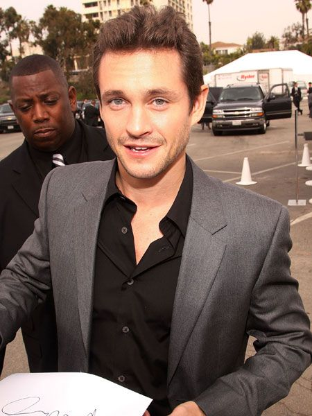 The blue-eyed boy works some English charm on a dedicated fan and looks utterly adorable doing so. What girl could say no to those piercing peepers? We'd happily switch places with his bodyguard and protect Hugh's beautiful bod  <br />