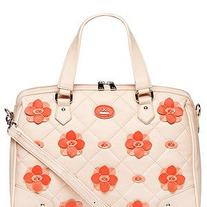 <p>You can never have too much floral in your wardrobe in our opinion. Which is why we'll be adding this pretty tan zip shopper with coral flowers to our collection.</p>