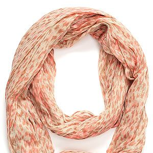 <p>Who said scarves had to be boring? This Accessorize snood with leopard print and neon coral hues is anything but.</p>