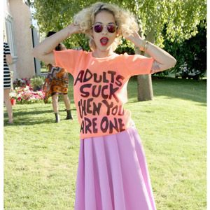 <p>Rita Ora is famed for dividing opinion with her fierce attitude to fashion and this eclectic look is set to do just that. From the playful print top (with its oh-so-true sentiment) to the A-line lilac midi skirt, this is definitely not one for us lesser mortals to attempt - but Rita pulls it off with serious style. Anyone else coveting the retro red lippy and flapper curls?</p>