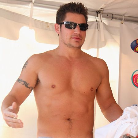 Showing his ex Jessica Simpson exactly what she's missing the stacked singer chooses his wardrobe carefully for a beach party in the Bahamas. The topless look is definitely one that gets our seal of approval- we demand all men with six packs dress like Nick  <br />