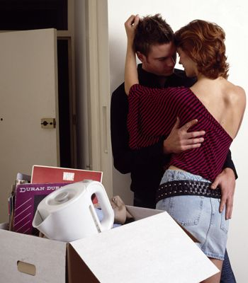 Ahhh, your very own love nest. Cosy nights in front of the TV, romantic dinners, sex on the kitchen table... or fighting for control of the remote, washing up battles and a fizzling sex life? Here's how to co-habit without crushing the romance<br />